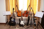 Learn Guitar Lessons,  Piano Lessons,  Singing Lessons,  Drum Lessons,  Se